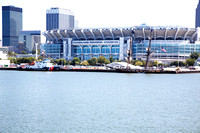 A US Coast Guard ship and the SSV Niagara in front of the Cleveland Browns Stadium